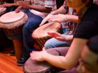 Students play African drums