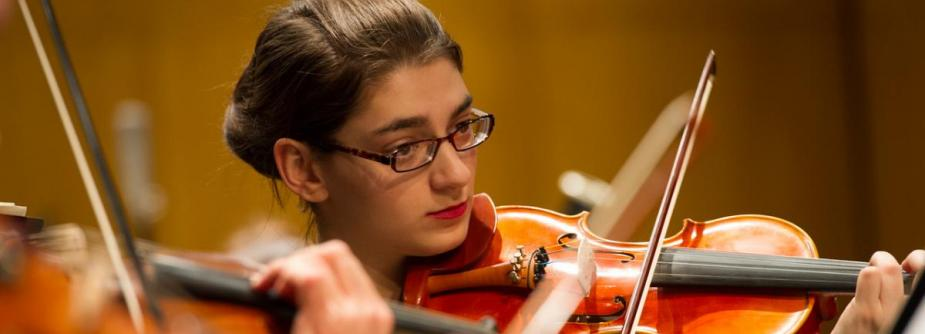 Student violinist performs at concert