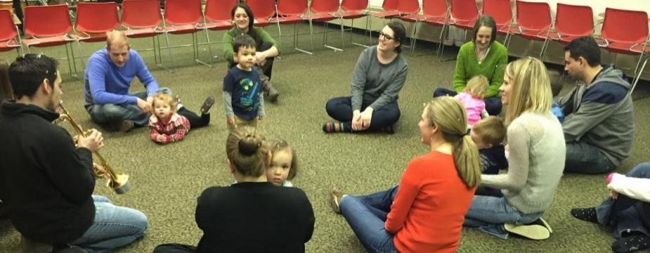 Children and parents at music workshop.