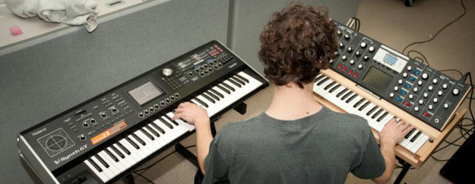 Student at two keyboards