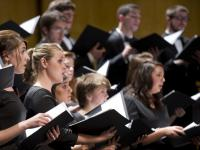 Chamber Choir students perform on stage.