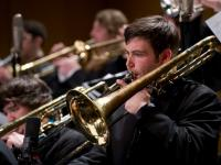 Student trombone players in concert.