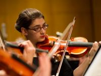 Buffalo State violin student performing with the Philharmonia Orchestra