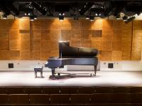 Grand piano in the recital hall.