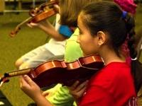 Young children playing violin