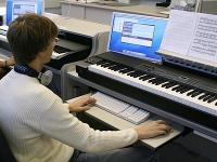 Student playing keyboards.
